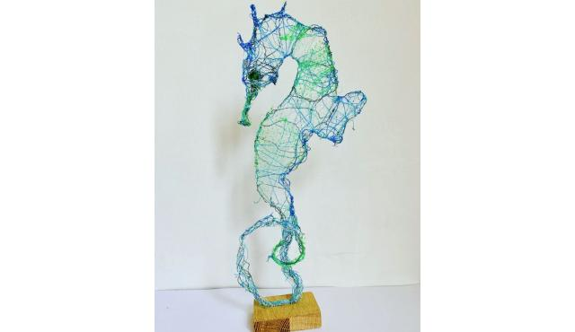 Seahorse made from wire and ghost gear